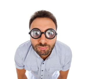 man with coke bottle lenses