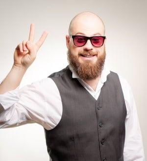 bald man with full beard wearing tinted sunglasses