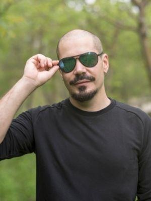 bald man in aviator sunglasses