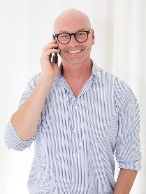 bald man wearing round glasses