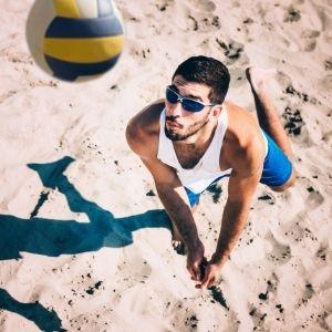 man playing beach volleyball
