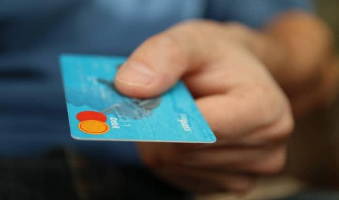 closeup of hand holding debit card