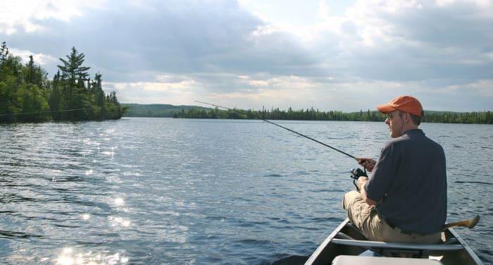 man in canoe fishing