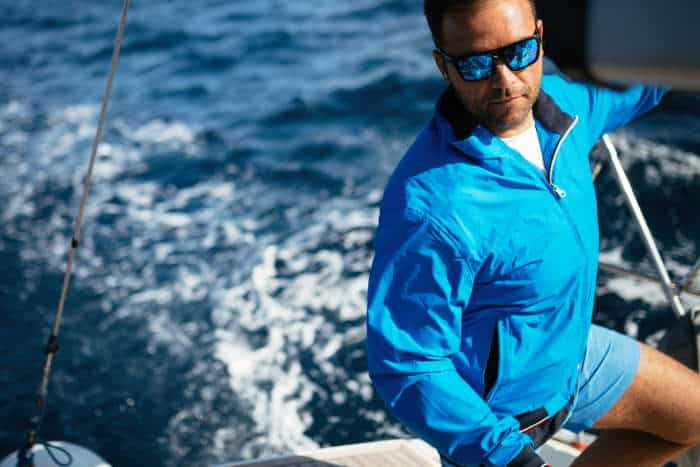 man in sunglasses sailing