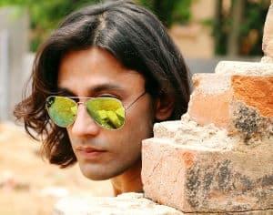 man wearing mirrored aviator sunglasses