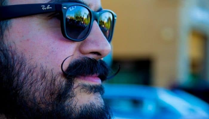 mustached man in Ray-Bans