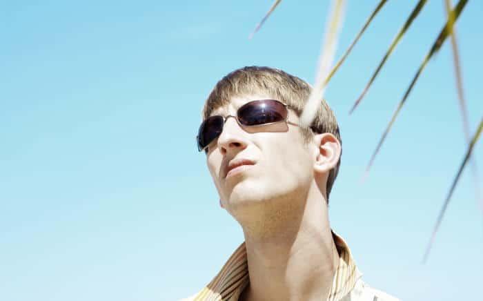young man wearing thin metal sunglasses