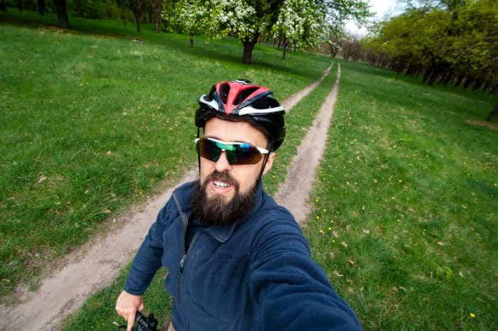 cyclist in sunglasses selfie
