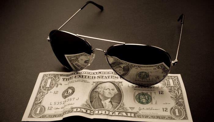 aviator sunglasses on $1 bill
