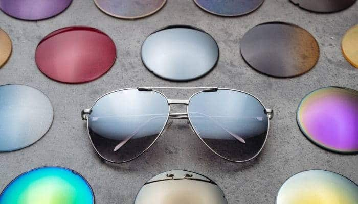 aviator sunglasses surrounded by sunglass lenses