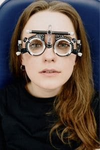 woman with optical test lenses